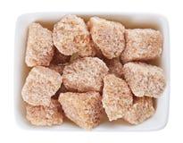 Brown lump cane sugar in sugar-basin Royalty Free Stock Image