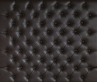 BROWN LUXURY PADDED STUDDED LEATHER BACKGROUND stock photography