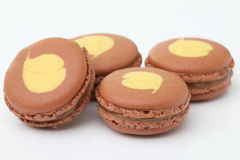 Brown macaroon on white background Royalty Free Stock Photos