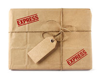 Brown mail delivery package with tag. Brown mail package parcel wrap express delivery with tag Royalty Free Stock Photos
