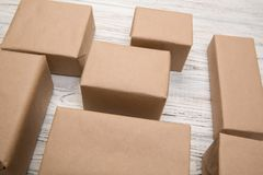 Brown mail package parcel blank for you design. Cardboard box on a wooden background.  stock images