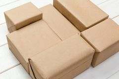 Brown mail package parcel blank for you design. Cardboard box on a wooden background.  stock photos