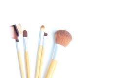 Brown make-up brushes on white background. Make-up brushes on white background royalty free stock image