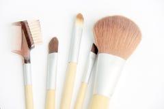 Brown make-up brushes on white background. Make-up brushes on white background royalty free stock photos