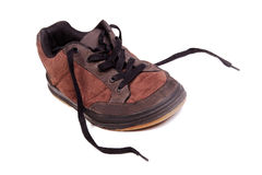 Brown male shoe with untied laces Royalty Free Stock Photos