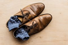 Brown male shoes with socks inside. Top view of brown male shoes with socks inside Stock Photos