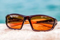 Brown male sunglass. Close up photo of brown male sunglass Royalty Free Stock Image