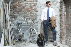 Brown. Man's style, handsome man with guitar outdoor Royalty Free Stock Image