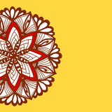 Brown mandala pattern border on yellow background Royalty Free Stock Photo