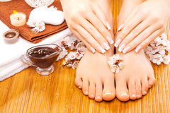 Brown manicure and pedicure on the bamboo Stock Images