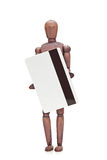 Brown mannequin holding credit card Royalty Free Stock Image