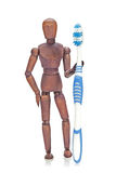 Brown mannequin holding toothbrush Royalty Free Stock Images