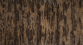 Brown marble stone tile. Like a tobacco leaf texture Royalty Free Stock Photos
