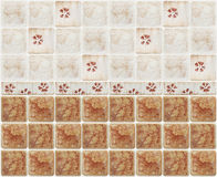 Brown marble tiles with floral decorations Royalty Free Stock Images