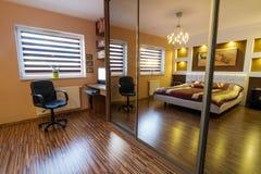 Brown master bedroom interior Royalty Free Stock Photos
