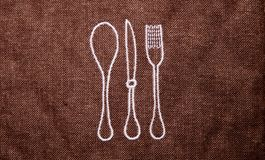 Brown mat for kitchen forks and spoons royalty free stock photo