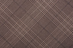 Brown material in geometric patterns, a background Royalty Free Stock Photo