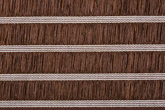 Brown material with lines, a background Royalty Free Stock Image