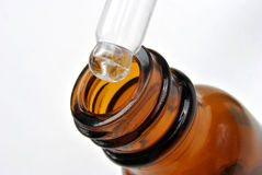 Brown medical bottle and a pipette Royalty Free Stock Images