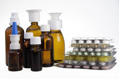 Brown medical bottles an Pills Royalty Free Stock Images