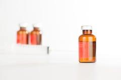 Brown medicine ampule on white Royalty Free Stock Photos