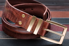 Brown men leather belt with golden buckle Stock Images