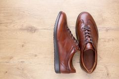 Brown men leather shoes on wooden background. Top view of Brown men leather shoes on wooden background Stock Photography
