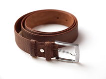 Brown men's belt 1. Textured brown men's belt with chrome clasp on white background Stock Photos