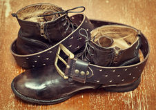 Brown men's shoes and leather belt on a wooden board Royalty Free Stock Photo
