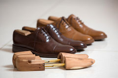 Brown men's shoes and shoe stratchers Stock Images