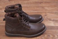 Brown men`s shoes. Standing on the floor Stock Photos