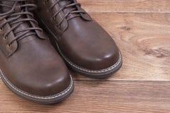 Brown men`s shoes. Standing on the floor Stock Photo