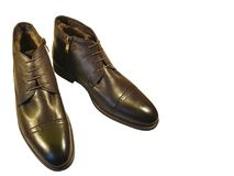 Brown men`s shoes winter isolated. Conceptn Royalty Free Stock Image