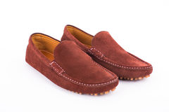 Brown mens suede leather loafers pair isolated on white backgrou Stock Photo