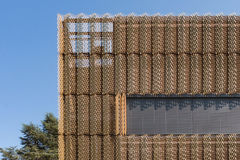 Brown Mesh Metal Building Wall Stock Photo