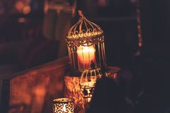 Brown Metal Cage With Lighted Candle stock images