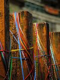 Brown Metal Fence With Blue Red and Yellow Rubber Band Selective Focus Photo royalty free stock photo