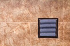 Brown metal industrial panel with ventilation grilles, closeup photo, front view. Detail of architecture design. Air circulation s Stock Image