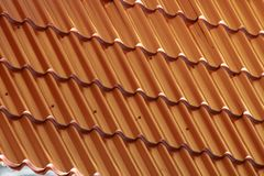 Brown metal roof, metal tile. Brown metal roof, metal tile Background royalty free stock images