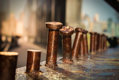 Brown metal screws bended iron rusty. A row of bended metal royalty free stock photos