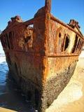 Brown Metal Shipwreck on Seashore during Daytime Royalty Free Stock Photos