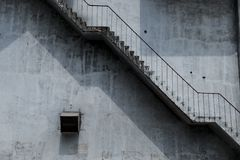 Brown Metal Staircase and Gray Painted Wall royalty free stock images