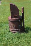 Brown metal trash can altered to be bear-proof Royalty Free Stock Image