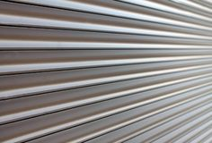 Brown metalu żaluzji drzwi jako wzór obrazy royalty free
