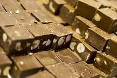 Brown milky chocolate bars with hazelnuts stock image