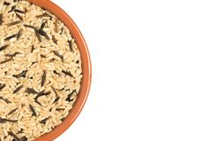Brown mixed Rice in bowl. Brown mixed Rice in brown bowl white background Stock Photos