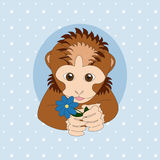 Brown monkey holding a blue flower Stock Image