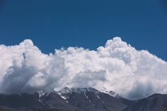 Brown Mountain Near Clouds Photo Stock Photo