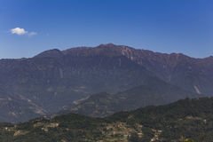 Brown mountain near Kangchenjunga mountain that view in the morning in Sikkim, India. Brown mountain near Kangchenjunga mountain that view in the morning in Royalty Free Stock Photos