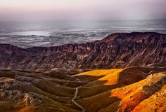 Brown Mountain Range Under White Sky during Daytime Stock Photos